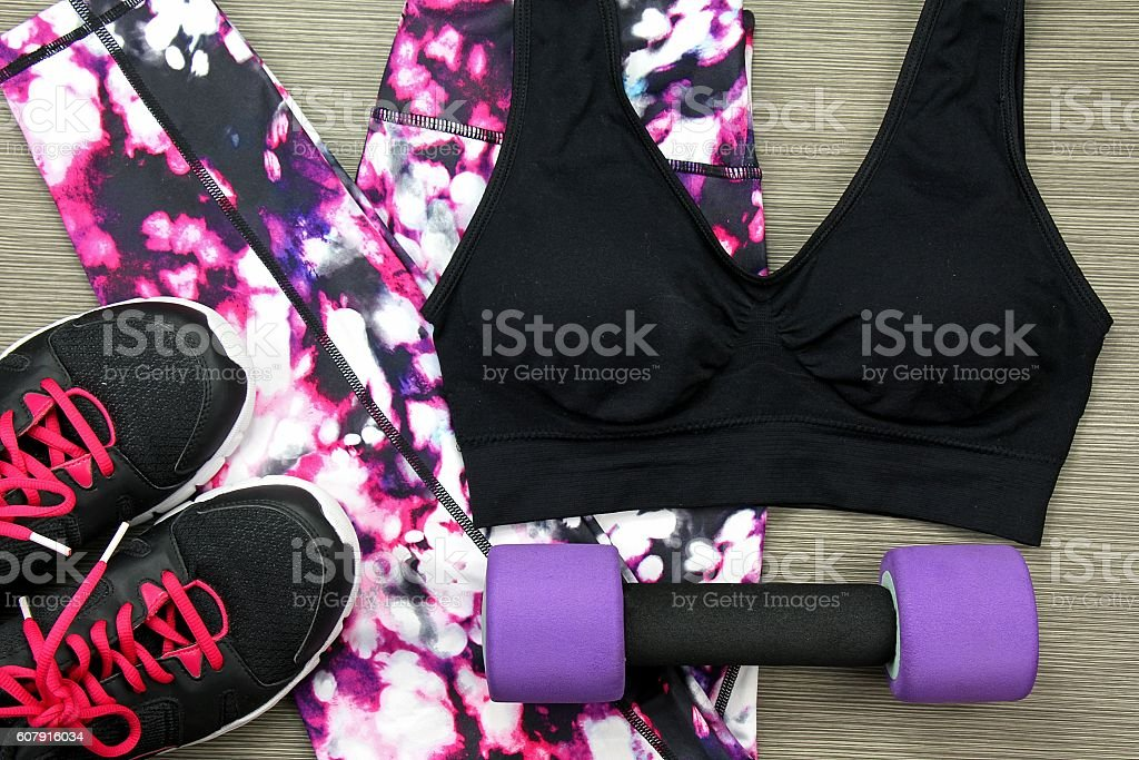 Women's sport wear and Dumbbell. Fitness wear and equipment. stock photo