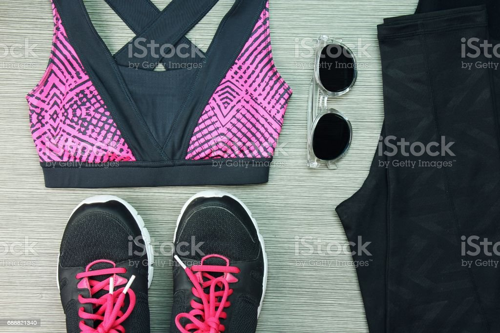 Women's sport wear, Gym fashion and accessories, Exercise Equipment, Healthy lifestyle concept, Shoes, Yoga Mat, Sport Bra, Sunglasses. stock photo