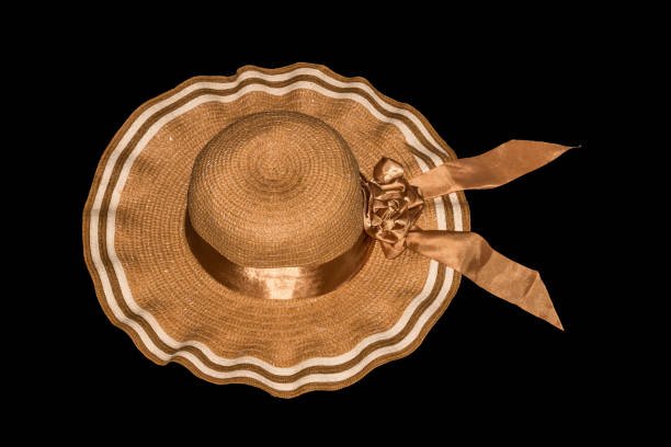 Women's straw hat with the brown ribbon isolated on black backgr stock photo