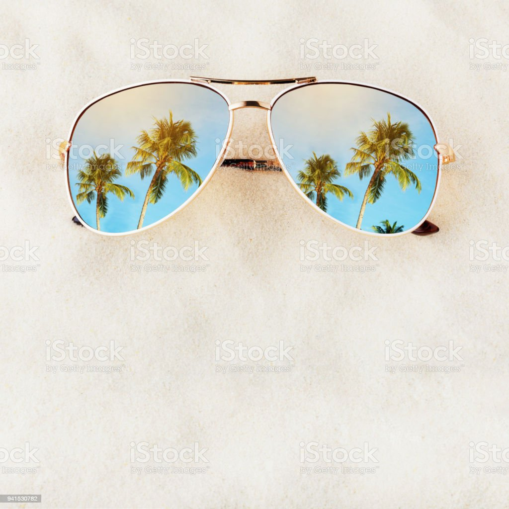 Women's Sunglasses no title on the sand with space for text, top view. Journey to the sea stock photo