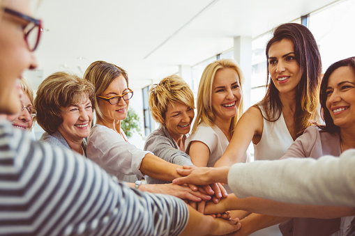 Womens Team Group Of Happy Women Joining Hands Stock Photo - Download Image Now