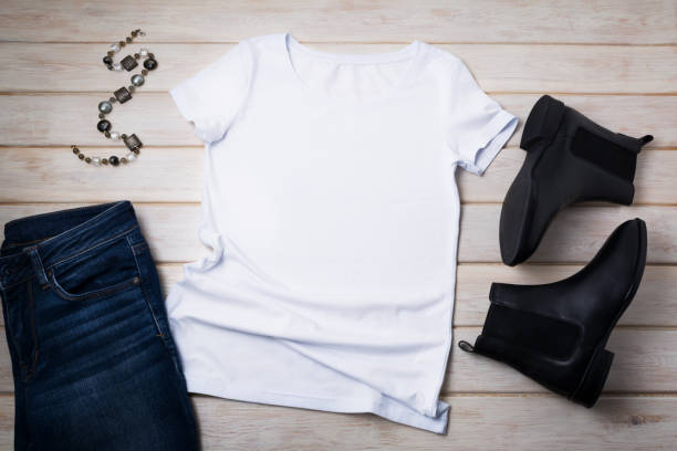 Women's T-shirt mockup with chelsea boots stock photo