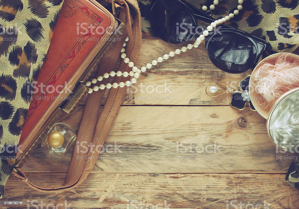 womens vintage accessories, powder box, scarf, necklace, perfume stock photo
