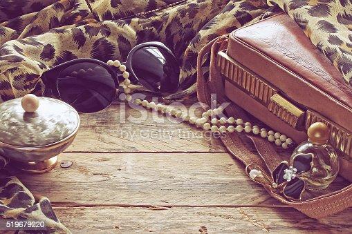 istock womens vintage accessories, powder box, scarf, necklace, sunglas 519679220
