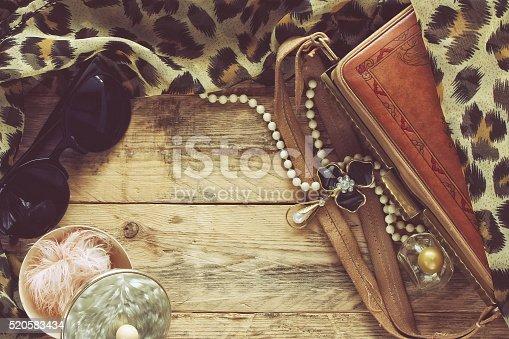istock womens vintage accessories, powder box, scarf, necklace, sunglas 520583434