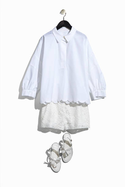 Women's white shirt and lace shorts with sandals stock photo