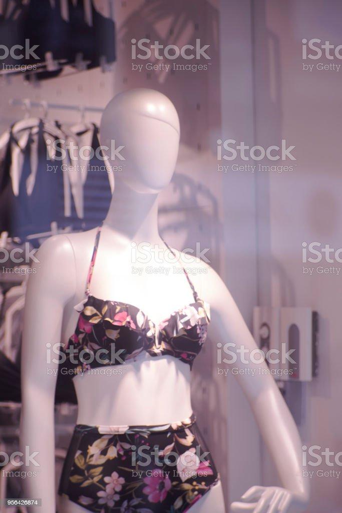 74793014810 Womenswear fashion shop window ladies store mannquins dummies wearing  underwear lingerie and swimwear. royalty-