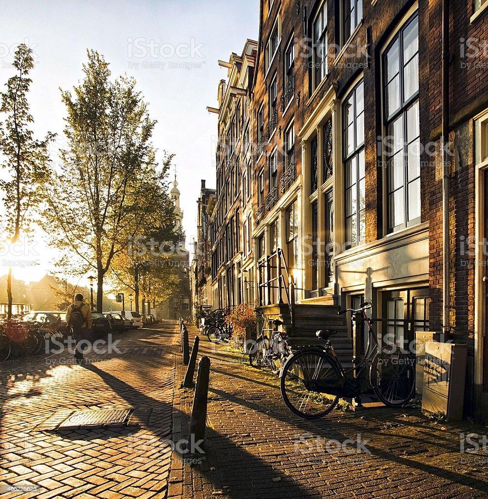 Wonderful and idyllic street scene at sunset in amsterdam - Royalty-free Adult Stock Photo