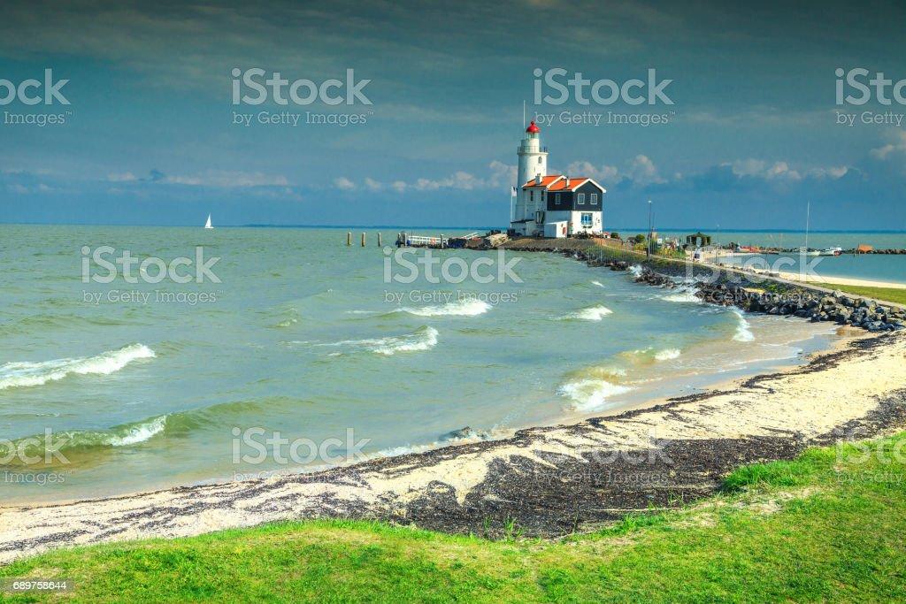Wonderful beach and lighthouse in Marken, Netherlands, Europe stock photo