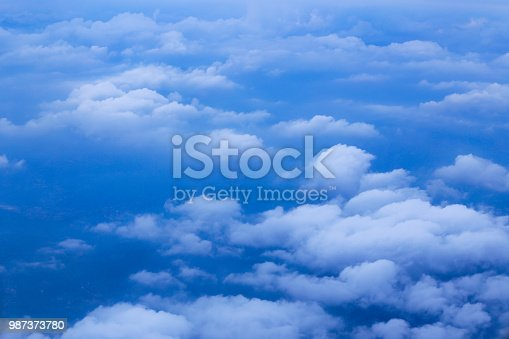 istock Wonderful clouds from airplane on blue sky 987373780