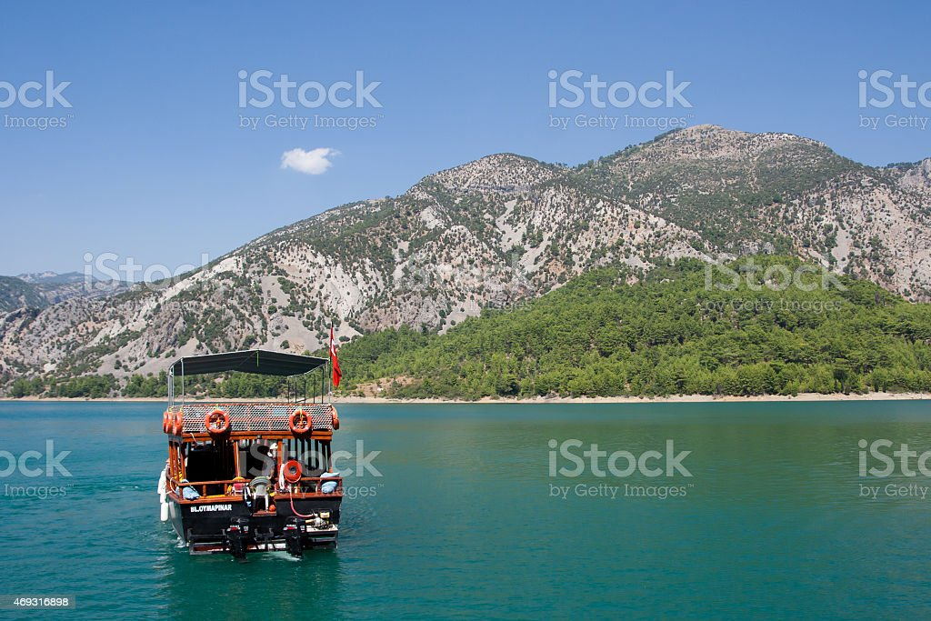 Wonderful Cruise on the Lake Surrounded by Mountains stock photo