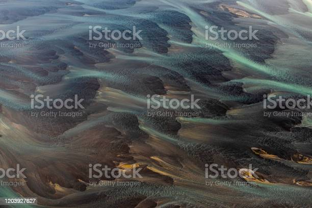 Photo of Wonderful flowing landscape of Iceland, with it's glacial rivers interflowing the landscape