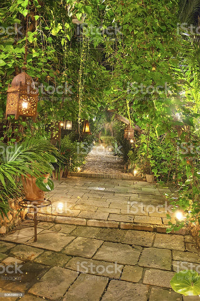 Wonderful Garden Path At Night, Illuminated By Candles, And Lanterns.  Royalty Free