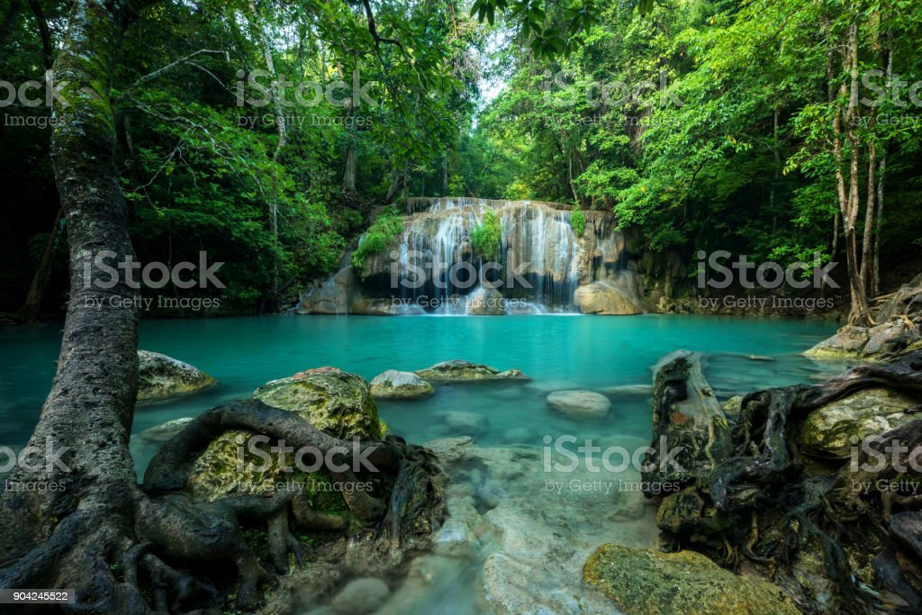 Wonderful green waterfall and nice for relaxation, Breathtaking and amazing turquoise water at the evergreen forest, Located Erawan waterfall Khanchanaburi Province, Thailand stock photo
