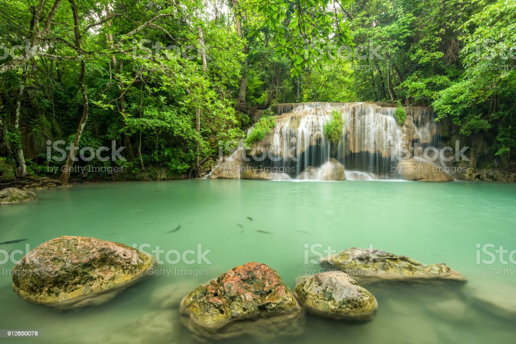 Wonderful green waterfall and nice for relaxation, Breathtaking and amazing green water at the evergreen forest, Located Erawan waterfall Khanchanaburi Province, Thailand stock photo