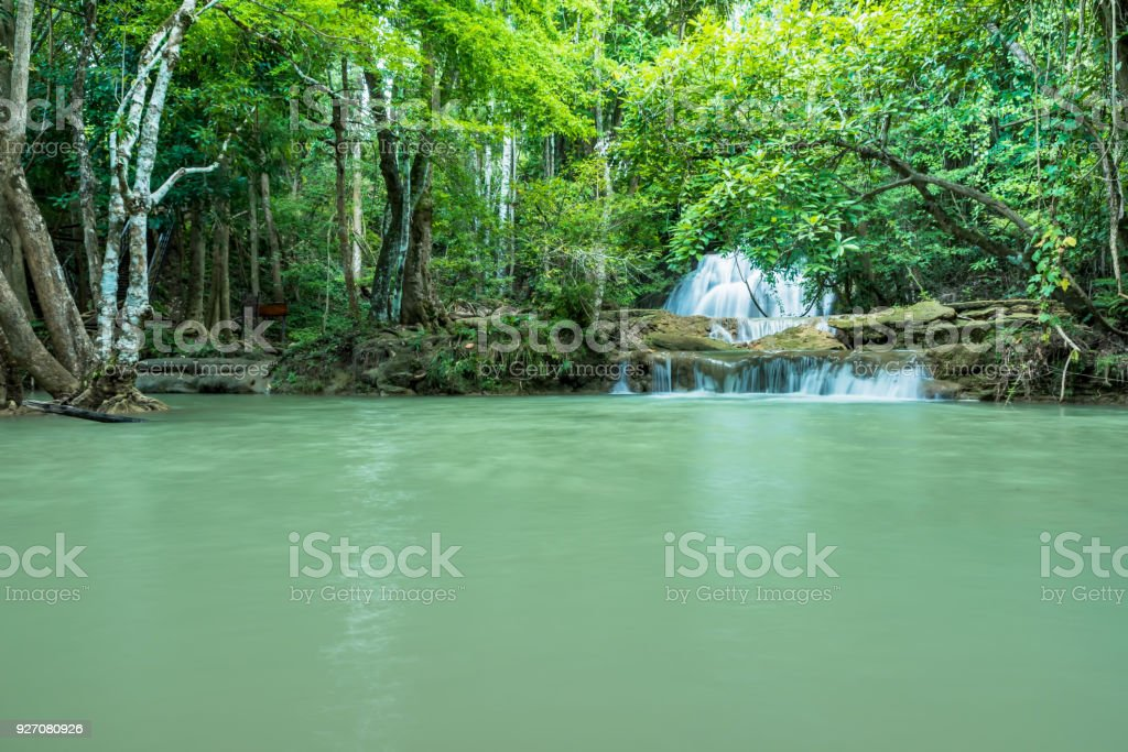 Wonderful green waterfall and nice for relaxation, Breathtaking and amazing turquoise water at the evergreen forest stock photo