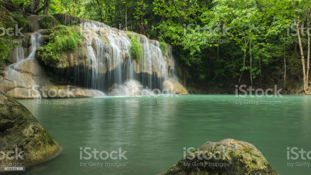 Wonderful green waterfall and nice for relaxation, Erawan waterfall located Kanchanaburi Province, Thailand stock photo