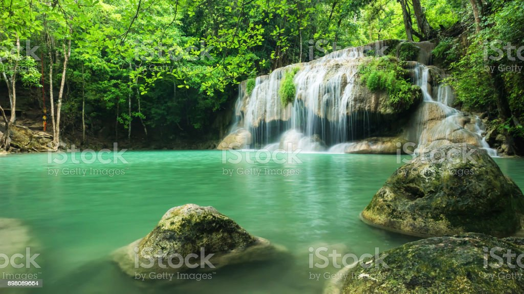 Wonderful green waterfall at deep forest, Erawan waterfall located Kanchanaburi Province, Thailand stock photo