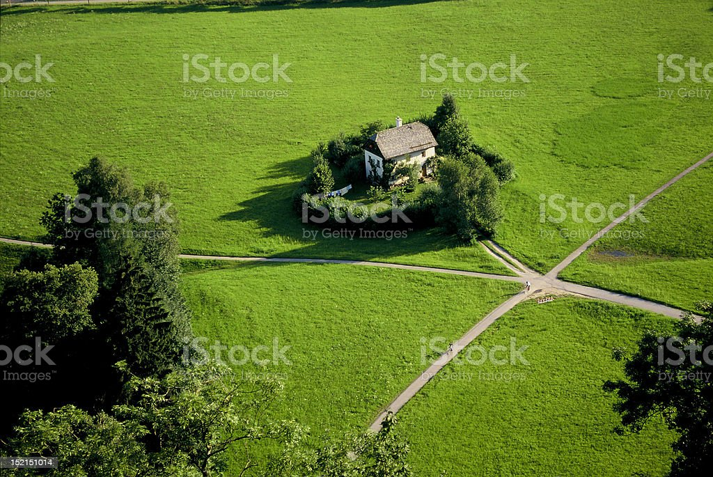 Wonderful home nestled in the green royalty-free stock photo