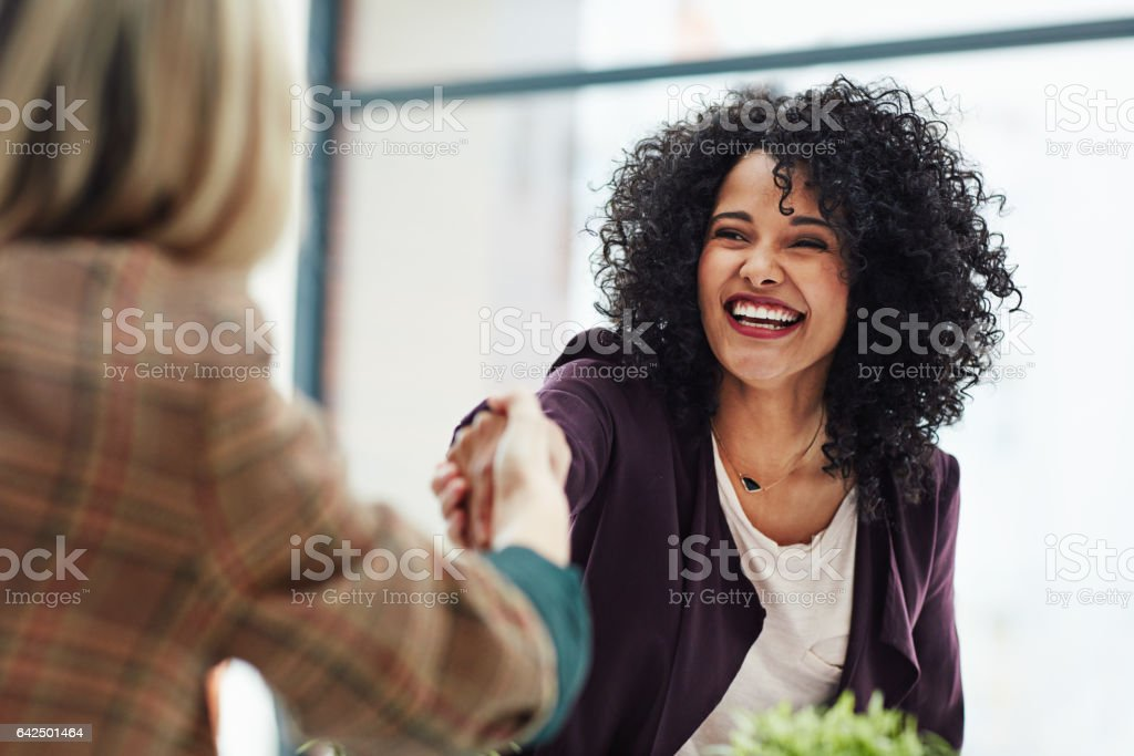 Wonderful, I'll see you first thing on Monday Shot of two colleagues shaking hands during a meeting at work Adult Stock Photo