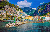 Wonderful Italy. The small haven of Amalfi village with a turquoise sea and colorful houses on the slopes of the coast.