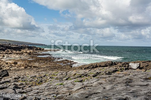 Wonderful landscape of the sea and limestone in Bothar nA hAillite, Geopark geosites, Wild Atlantic Way, beautiful sunny spring day in County Clare in Ireland