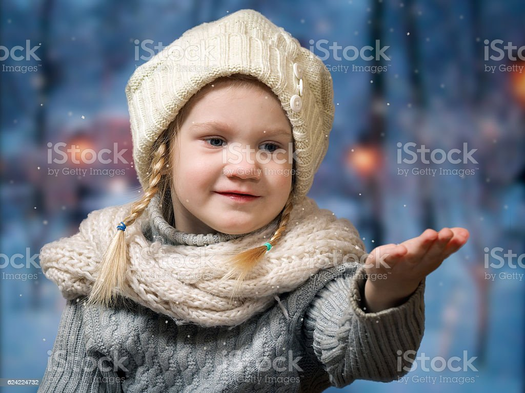 wonderful little girl catches snowflakes falling on hand stock photo