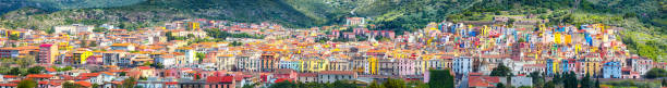 Wonderful morning panorama of colourful houses of old town Bosa in Sardinia stock photo