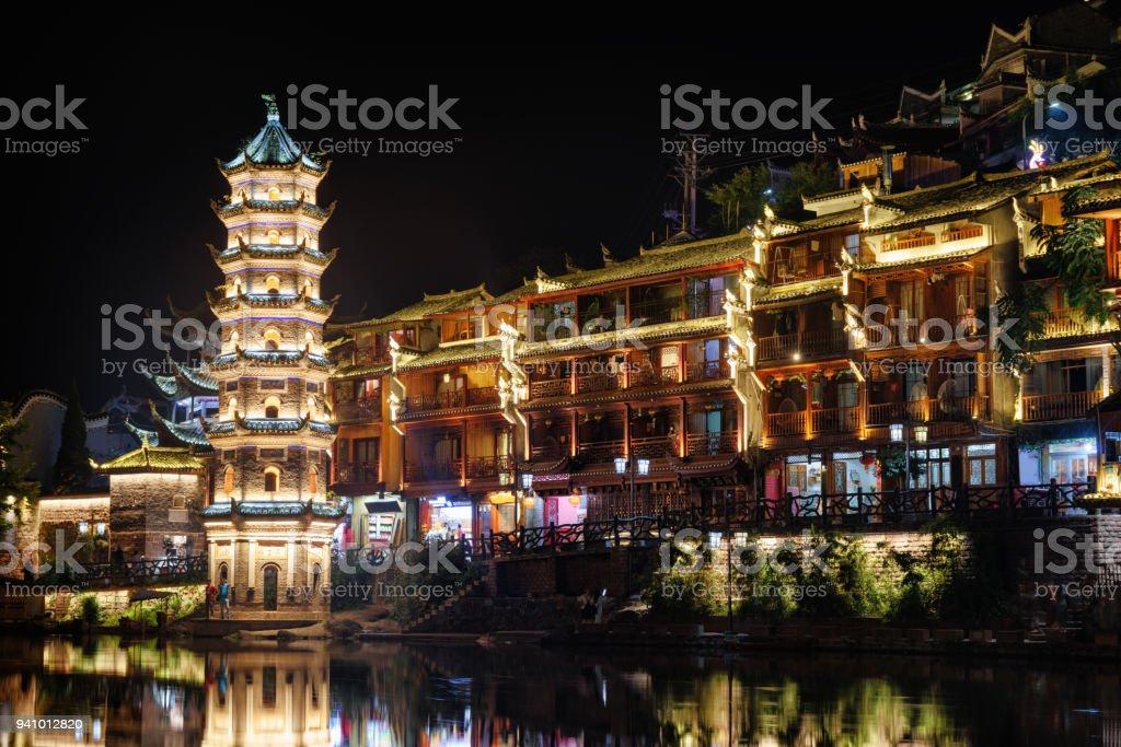 Wonderful night view of the Wanming Pagoda, Phoenix Ancient Town stock photo