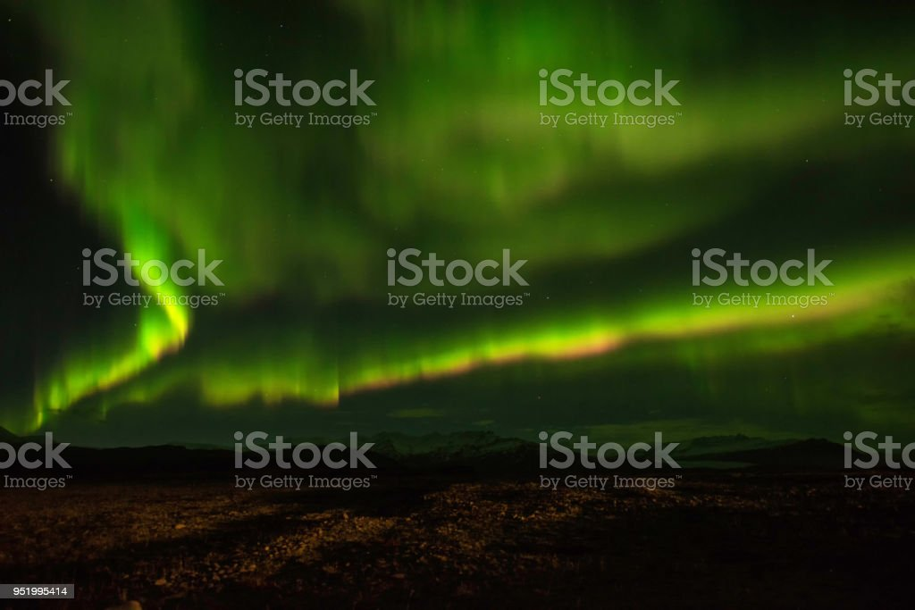 A wonderful night with Kp 5 . Northern lights mountain in Iceland. stock photo