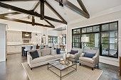 istock Wonderful open floorplan in new luxury home with black trim windows 1276567523