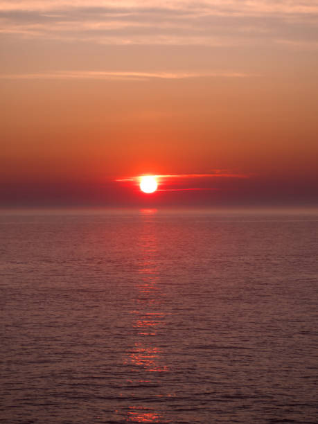Wonderful Orange and red sunset over the sea. stock photo