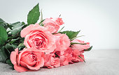 Wonderful pink roses on wooden table