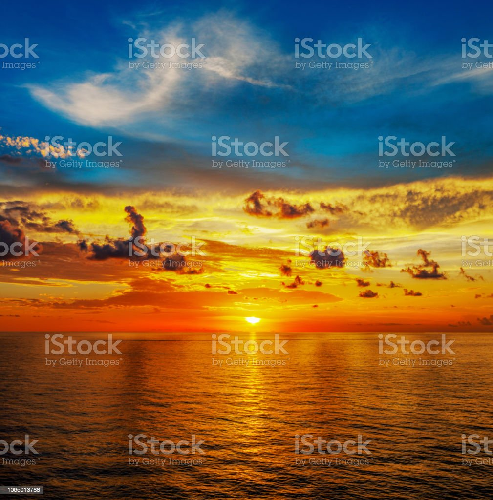 Wonderful sea landscape with colorful clouds and sunrise stock photo