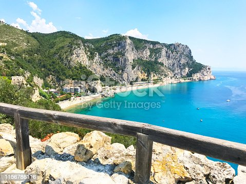 istock Wonderful sea view from the top on the mountain with wooden fence. Mediterranean sea, mountains and beach. Paradise resort 1156786116