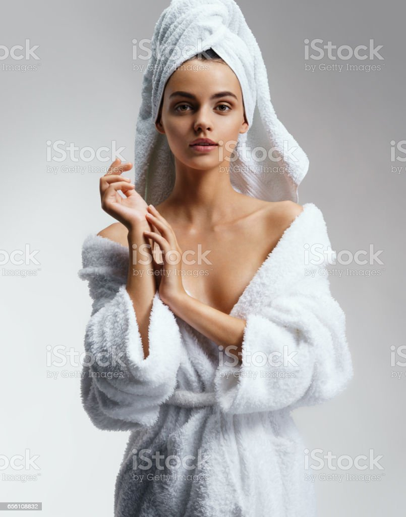 Wonderful slim girl in white bathrobe after spa. - foto de stock