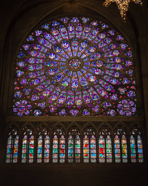 wonderful stained glass window with sacred images. - rose window stock pictures, royalty-free photos & images