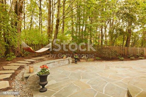 Large stone patio on beautiful property.