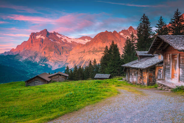Wonderful summer alpine location with wooden huts and mountains, Switzerland stock photo