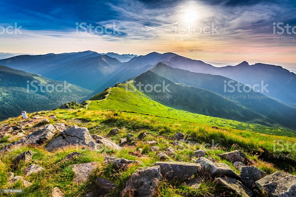 Wonderful sunset in mountains in summer stock photo
