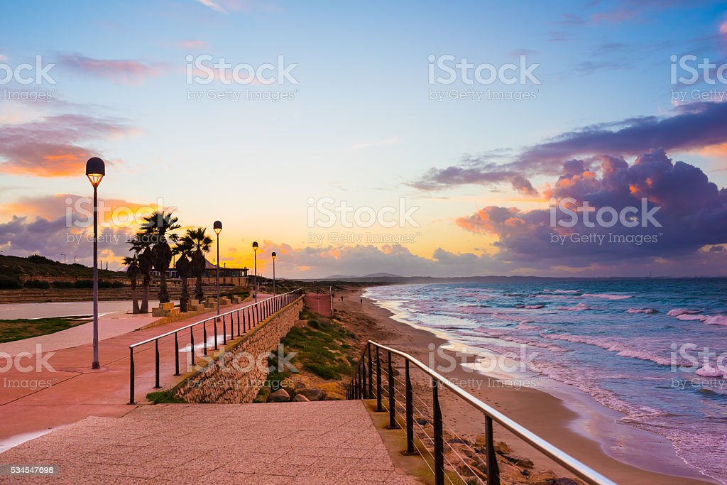 Wonderful sunset over a quiet sea and view of seafront stock photo