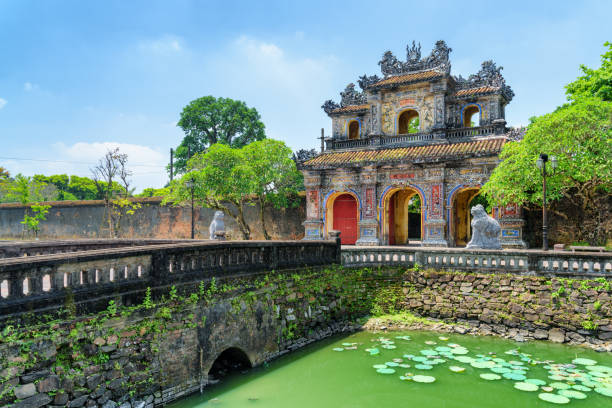 Wonderful view of the East Gate (Hien Nhon Gate), Hue Wonderful view of the East Gate (Hien Nhon Gate) to the Citadel and a moat surrounding the Imperial City with the Purple Forbidden City in Hue, Vietnam. Hue is a popular tourist destination of Asia. royalty stock pictures, royalty-free photos & images