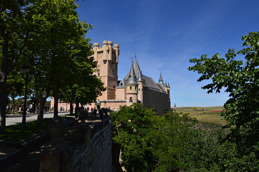 Wonderful Views Of The Alcazar Castle Behind A Grove In Segovia. Architecture, Travel, History.