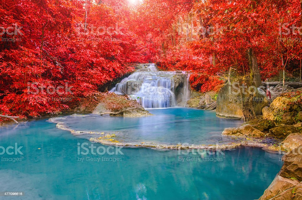 Wonderful Waterfall with rainbows in deep forest at national par stock photo