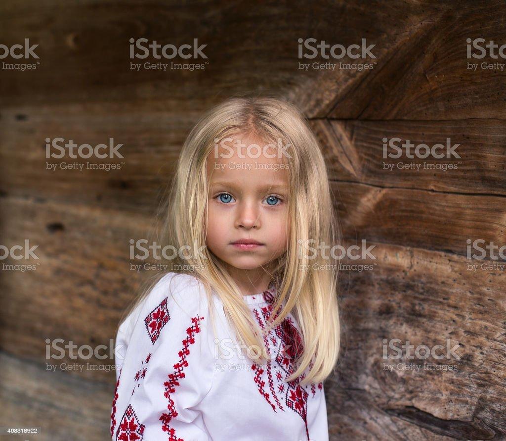Wonderfull little blonde girl in ukrainian national costume stock photo