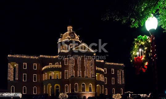 The Harrison County Courthouse is swathed in white lights for the Wonderland of Lights event in downtown Marshall, Texas.  Each year the town creates a Christmas wonderland with ice skating, carousel, train rides, Santa visits and Christmas lights everywhere!