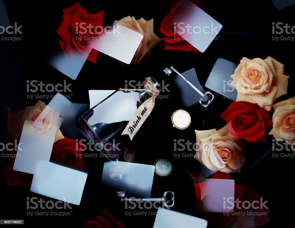 Wonderland playing cards, red and white roses, key, clock, poison. stock photo