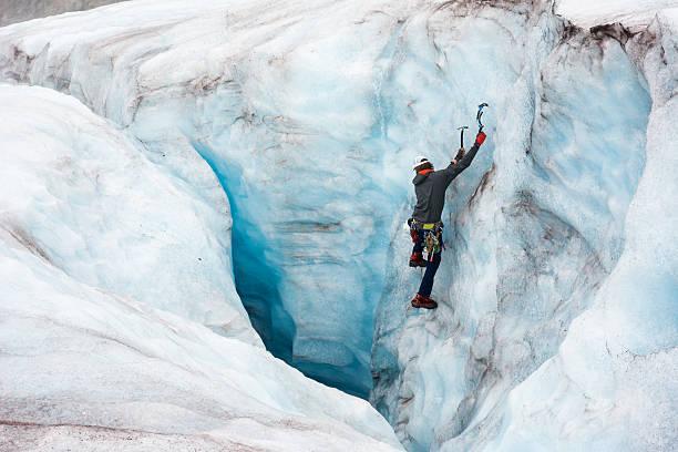 wonderlust ice climbing in crevasse - アイスクライミング ストックフォトと画像