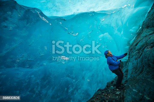istock wonderlust in a blue ice cave 598830826