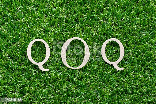 istock Wood alphabet in word QOQ (abbreviation of quarter on quarter) on artificial green grass background 1079348186